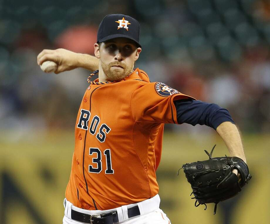August 1: Astros 3, Blue Jays 1  Houston Astros starting pitcher Collin McHugh (31) pitches during the first inning of an MLB baseball game at Minute Maid Park, Friday, Aug. 1, 2014, in Houston.  ( Karen Warren / Houston Chronicle  ) Photo: Karen Warren, Houston Chronicle