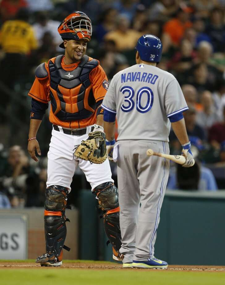 Carlos Corporan laughs with Blue Jays catcher Dioner Navarro before Navarro's at-bat during the first inning. Photo: Karen Warren, Houston Chronicle