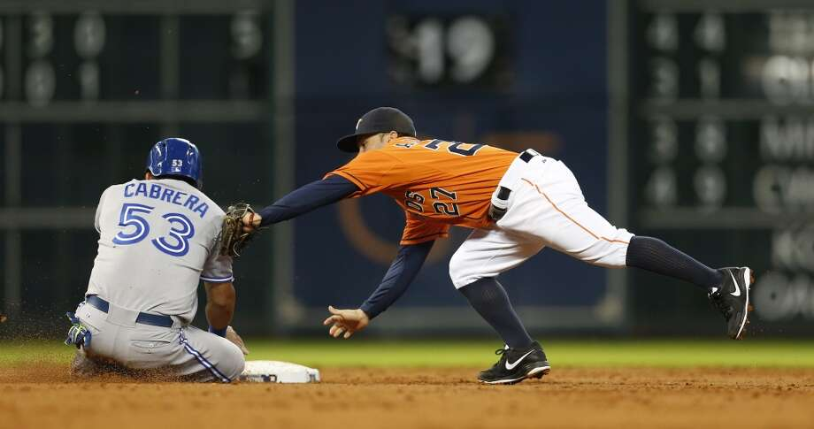 Blue Jays left fielder Melky Cabrera is tagged out at second base by Jose Altuve (27) during the third inning. Photo: Karen Warren, Houston Chronicle