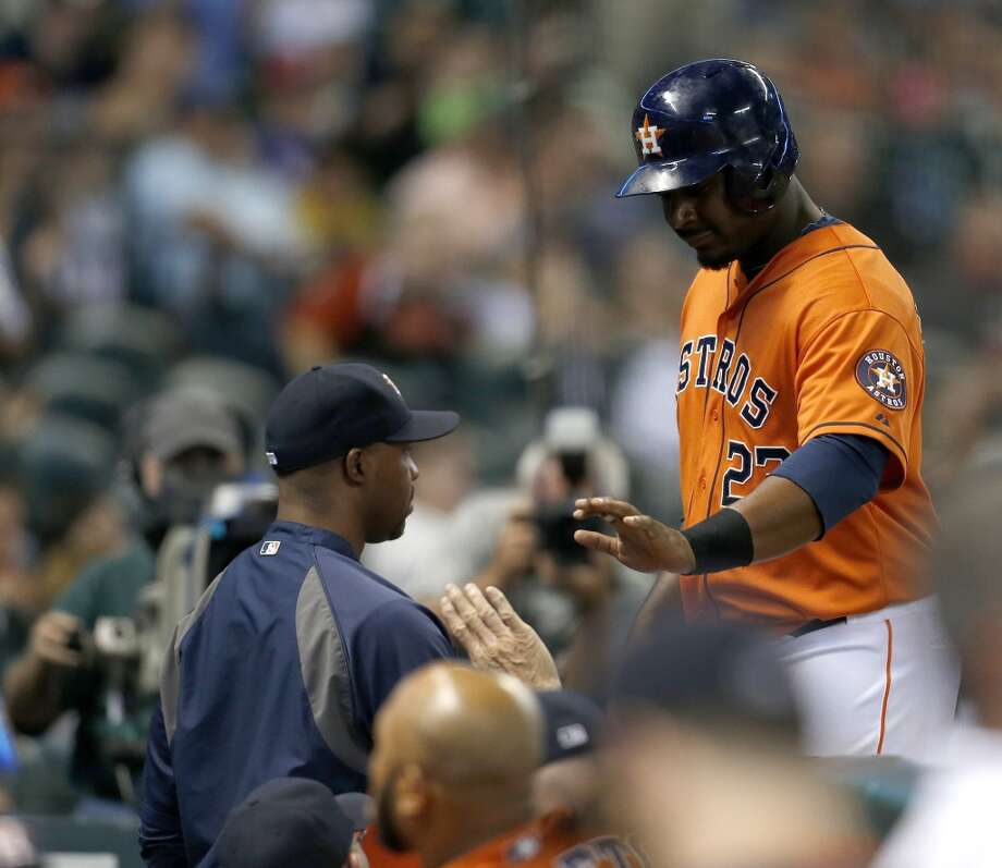 Chris Carter comes in after an RBI single during the fourth inning. Photo: Karen Warren, Houston Chronicle