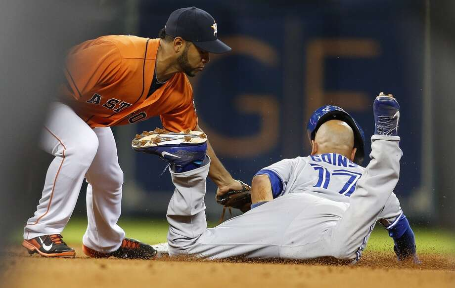 Gregorio Petit catches Blue Jays second baseman Ryan Goins stealing second base during the fifth inning. Photo: Karen Warren, Houston Chronicle