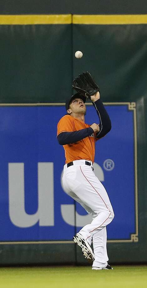 Jake Marisnick catches a fly out during the fifth inning. Photo: Karen Warren, Houston Chronicle