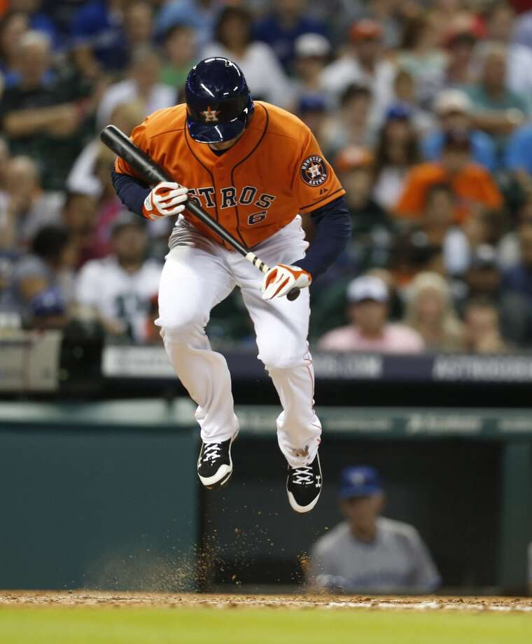 Jake Marisnick hops up to avoid a ball during his at-bat in the fifth inning. Photo: Karen Warren, Houston Chronicle