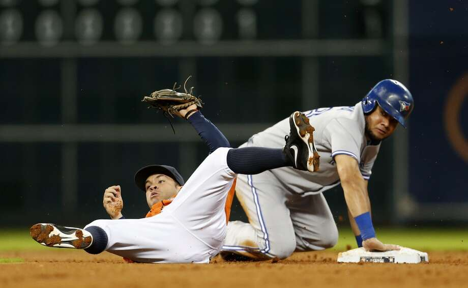 Blue Jays left fielder Melky Cabrera is tagged out at second base by Jose Altuve during the third inning. Photo: Karen Warren, Houston Chronicle