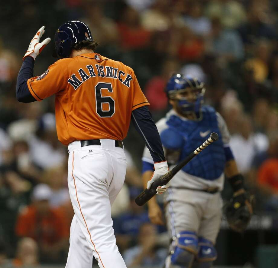 Jake Marisnick walks back to the plate after a strike during the seventh inning. Photo: Karen Warren, Houston Chronicle