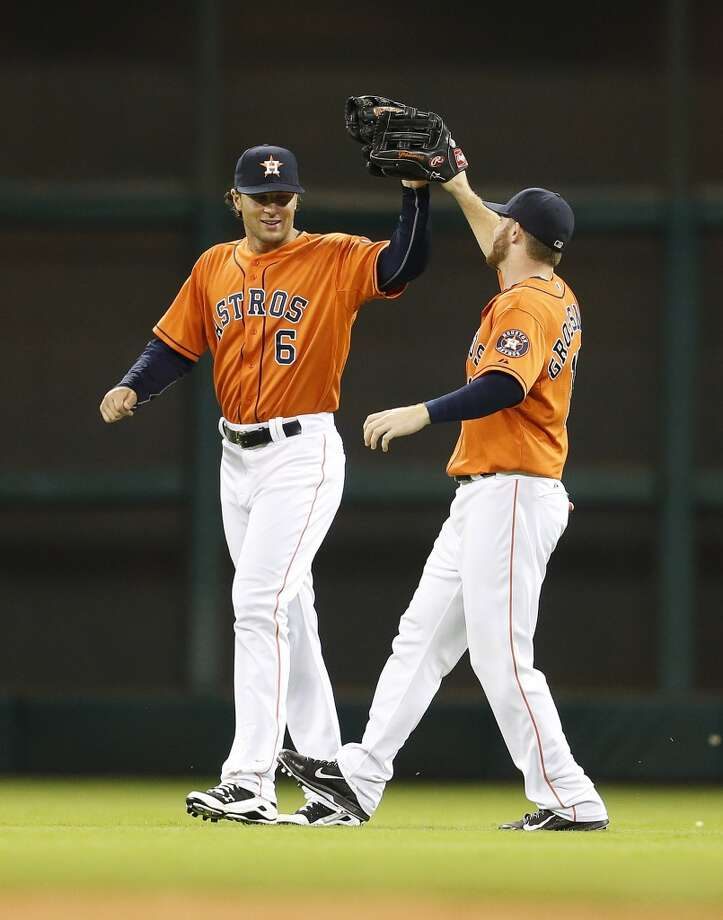 Jake Marisnick, left, and Robbie Grossman celebrate the Astros win after the final out. Photo: Karen Warren, Houston Chronicle