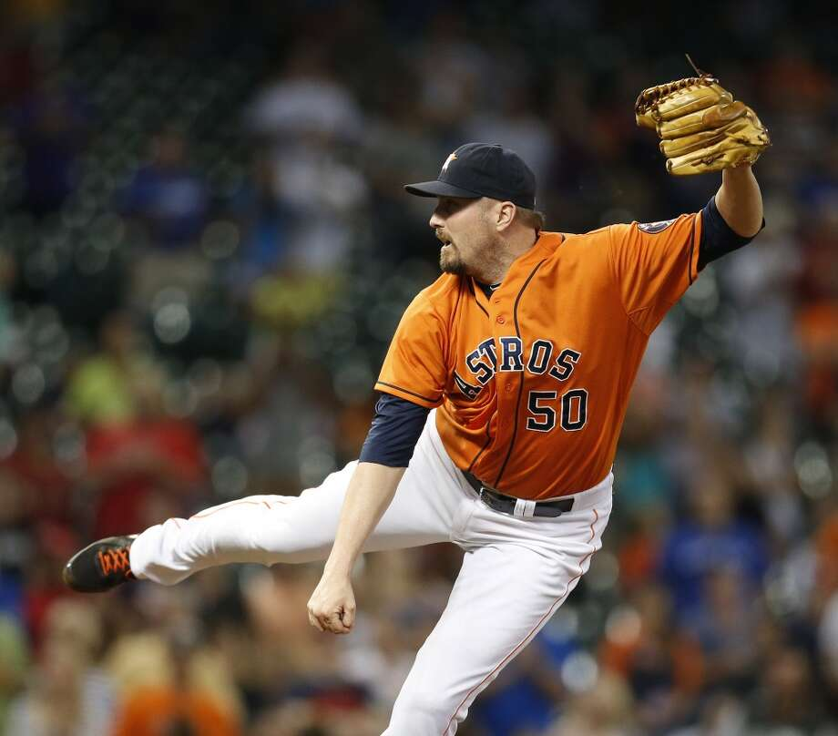 Chad Qualls pitches during the ninth inning. Photo: Karen Warren, Houston Chronicle