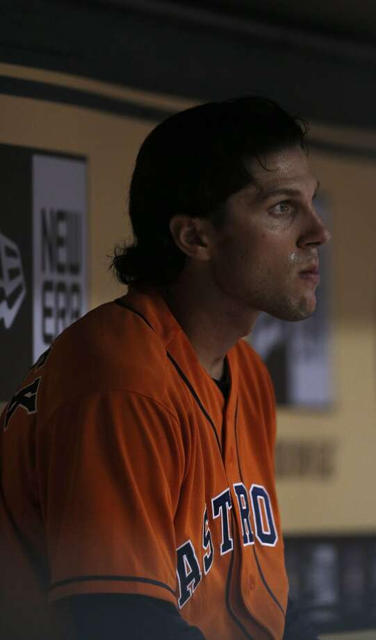 Jake Marisnick sits in the dugout during the fifth inning. Photo: Karen Warren, Houston Chronicle