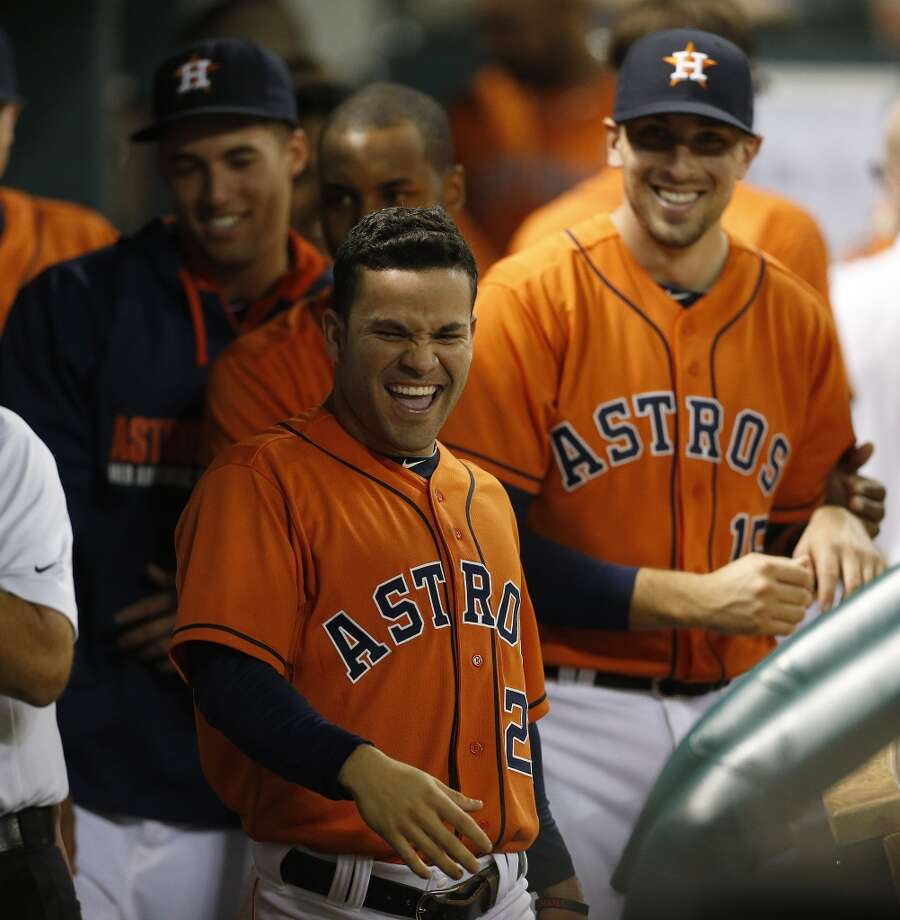 Jose Altuve smiles in the dugout after scoring a run during the eighth inning. Photo: Karen Warren, Houston Chronicle