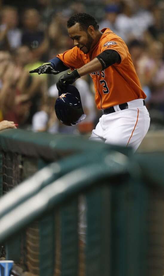 Gregorio Petit returns to the dugout after hitting a home run during the eighth inning. Photo: Karen Warren, Houston Chronicle