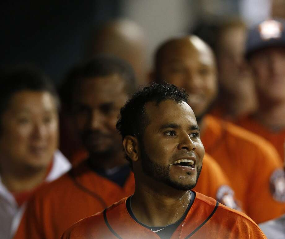 Gregorio Petit smiles in the dugout after hitting a home run during the eighth inning. Photo: Karen Warren, Houston Chronicle