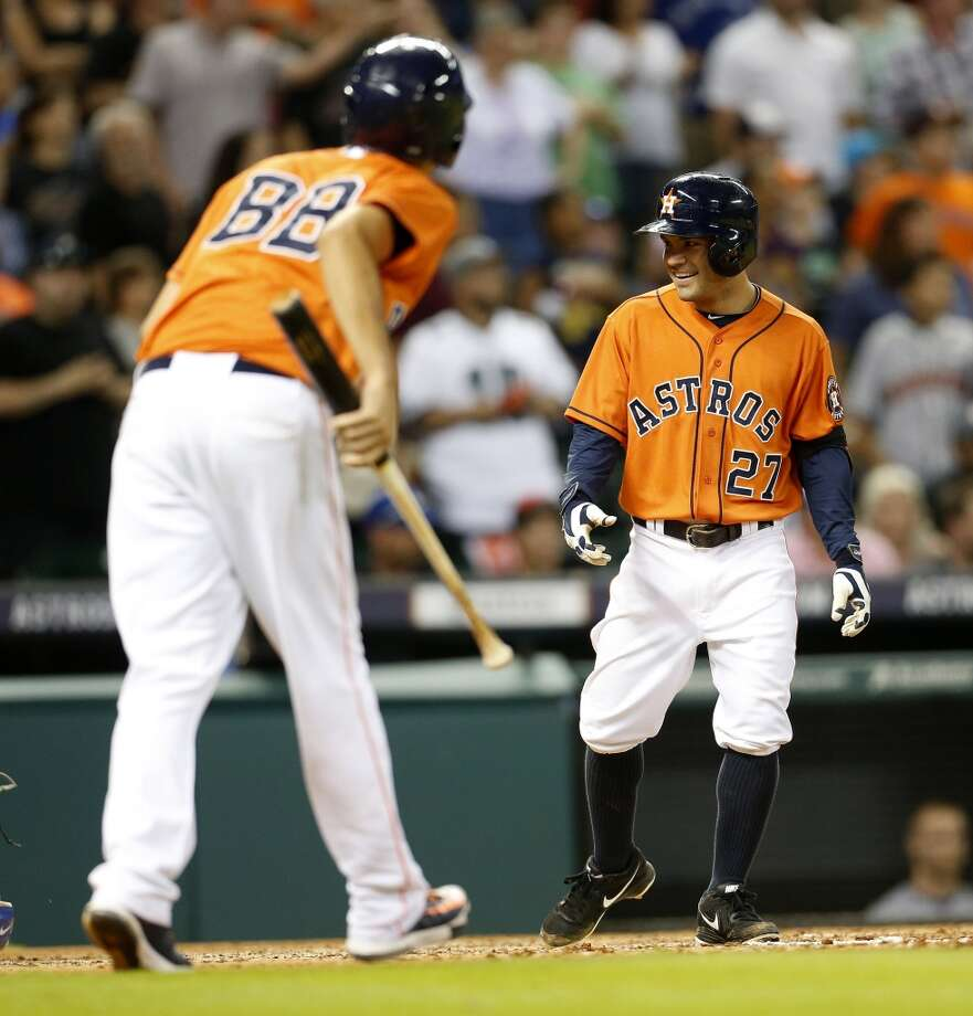 Jose Altuve (27) smiles as he reaches home plate after being called back as a ground-rule double during the eighth inning. Photo: Karen Warren, Houston Chronicle