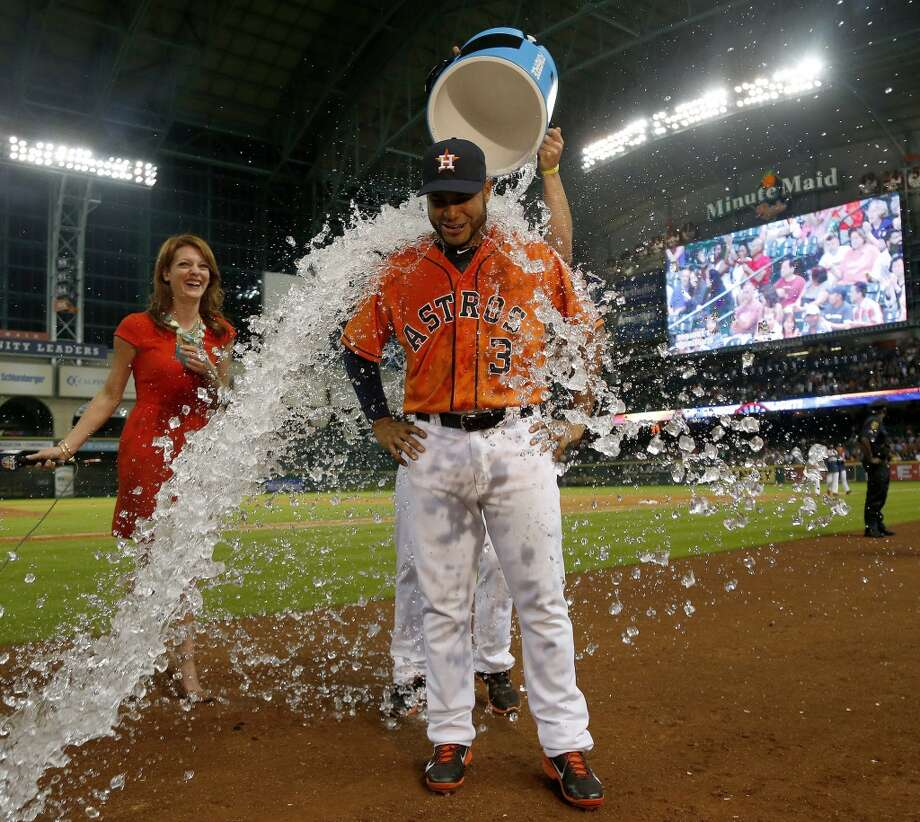 Gregorio Petit (3) is dunked with water by George Springer after Petit hit a home run in the eighth inning. Photo: Karen Warren, Houston Chronicle