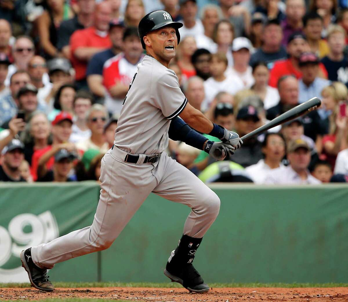 New York Yankees' Derek Jeter watches his two-run double against the Boston Red Sox during the third inning of a baseball game at Fenway Park in Boston Saturday, Aug. 2, 2014. (AP Photo/Winslow Townson) ORG XMIT: BXF108