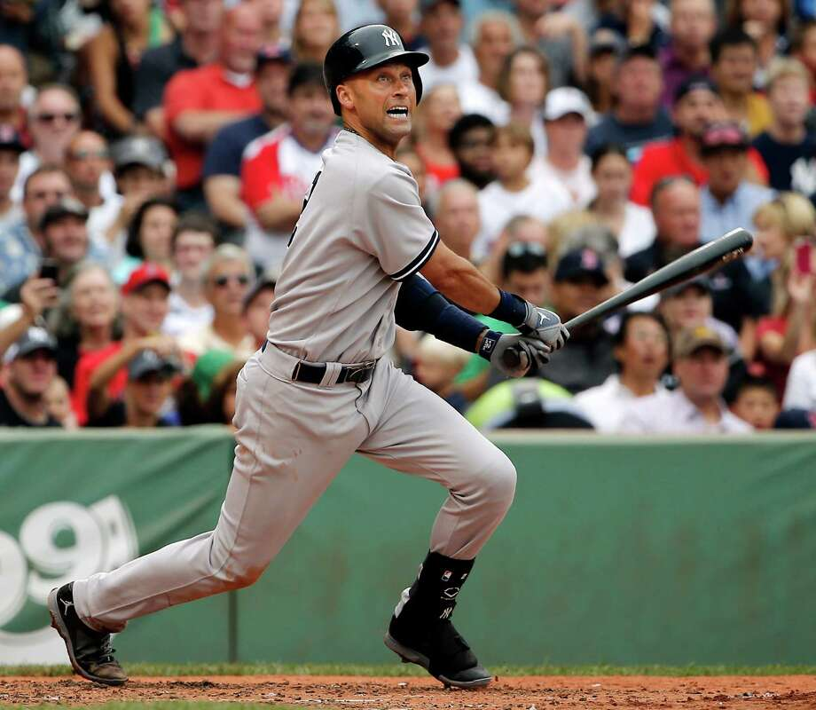 New York Yankees' Derek Jeter watches his two-run double against the Boston Red Sox during the third inning of a baseball game at Fenway Park in Boston Saturday, Aug. 2, 2014. (AP Photo/Winslow Townson) ORG XMIT: BXF108 Photo: Winslow Townson / FR170221 AP
