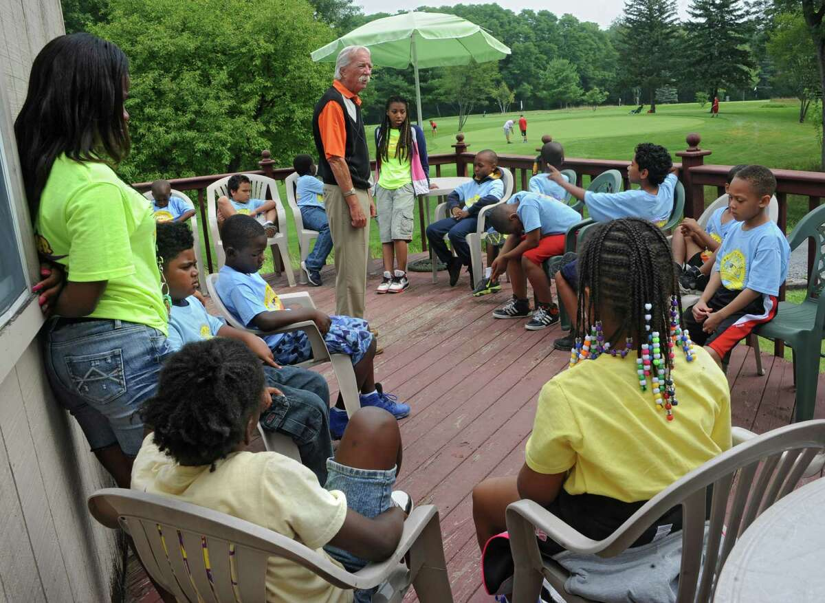 Course owner Dale Ezyk teaches children from the city of Albany golf etiquette and rules before they get some golf lessons during a program at Colonial Acres Golf Course on Friday, Aug. 1, 2014 in Glenmont, N.Y. (Lori Van Buren / Times Union)