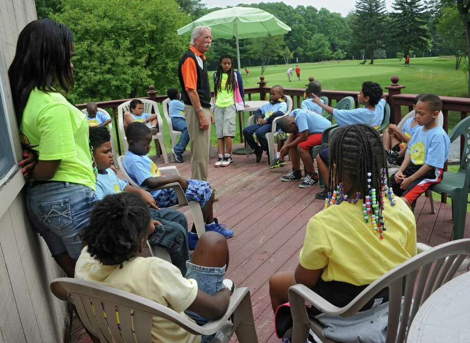 Course owner Dale Ezyk teaches children from the city of Albany golf etiquette and rules before they get some golf lessons during a program at Colonial Acres Golf Course on Friday, Aug. 1, 2014 in Glenmont, N.Y.  (Lori Van Buren / Times Union) Photo: Lori Van Buren / 00028020A