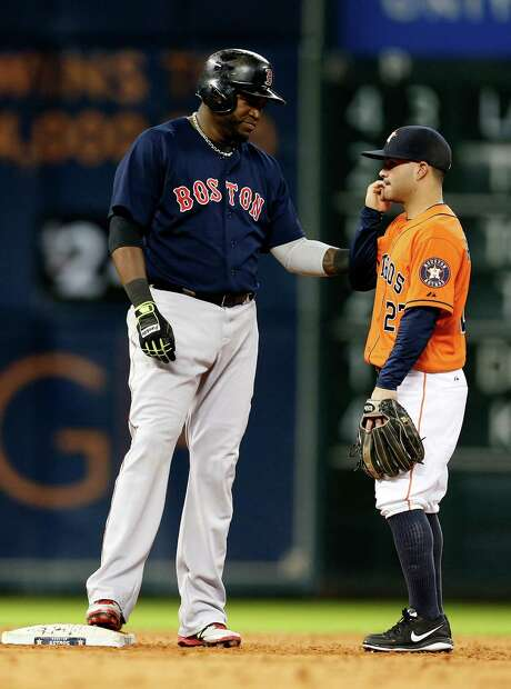 A couple of hitting machines in outsized Red Sox DH David Ortiz, left, and diminutive Astros second baseman Jose Altuve chat at Minute Maid Park in July. Photo: Karen Warren, Staff / © 2014 Houston Chronicle