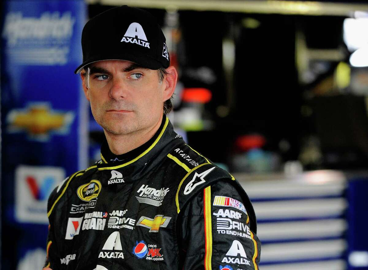 LONG POND, PA - AUGUST 02: Jeff Gordon, driver of the #24 Axalta Chevrolet, looks on from in the garage during practice for the NASCAR Sprint Cup Series GoBowling.com 400 at Pocono Raceway on August 2, 2014 in Long Pond, Pennsylvania. (Photo by Jared C. Tilton/Getty Images) ORG XMIT: 504827363