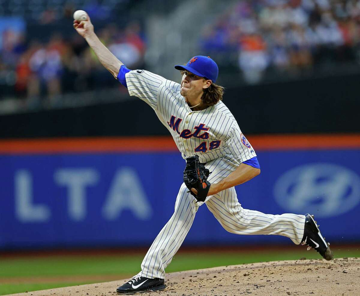 NEW YORK, NY - AUGUST 2: Jacob deGrom #48 of the New York Mets delivers a pitch against the San Francisco Giants on August 2, 2014 at Citi Field in the Flushing neighborhood of the Queens borough of New York City. (Photo by Rich Schultz/Getty Images) ORG XMIT: 477587313