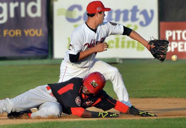 Batavia Muckdogs' shortstop Javier Lopez beats the throw to Tri-City ValleyCats' Mott Hyde, top, during Saturday's game at Bruno Stadium August 3, 2014, in Troy, NY.  (John Carl D'Annibale / Times Union) Photo: John Carl D'Annibale / 00027951A