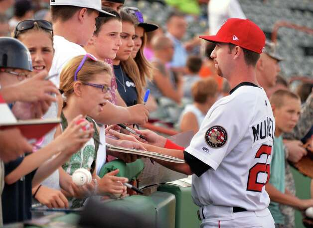 Tri-City ValleyCats' pitcher #23 Chris Munnelly signs autographs beforeSaturday's game against the Batavia Muckdogs at Bruno Stadium August 3, 2014, in Troy, NY.  (John Carl D'Annibale / Times Union) Photo: John Carl D'Annibale / 00027951A