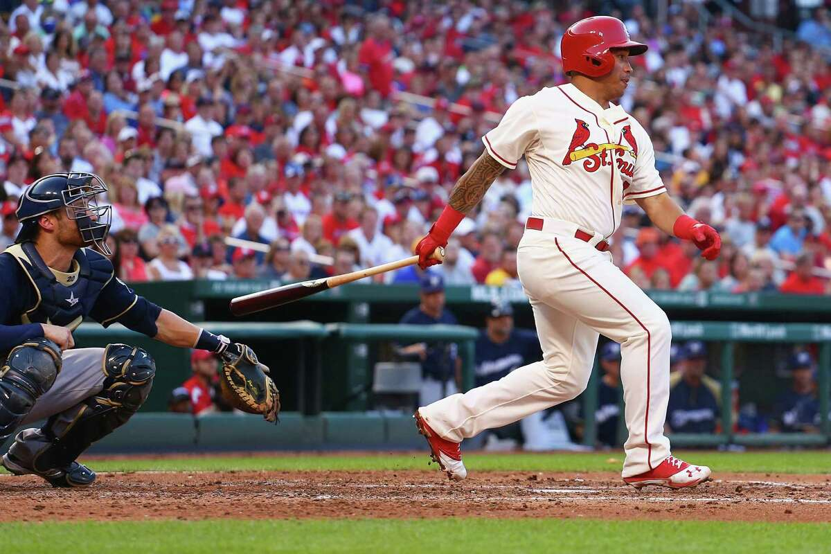 ST. LOUIS, MO - AUGUST 2: Kolten Wong #16 of the St. Louis Cardinals hits a two-RBI single in the second inning against the Milwaukee Brewers at Busch Stadium on August 2, 2014 in St. Louis, Missouri. (Photo by Dilip Vishwanat/Getty Images) ORG XMIT: 477587323