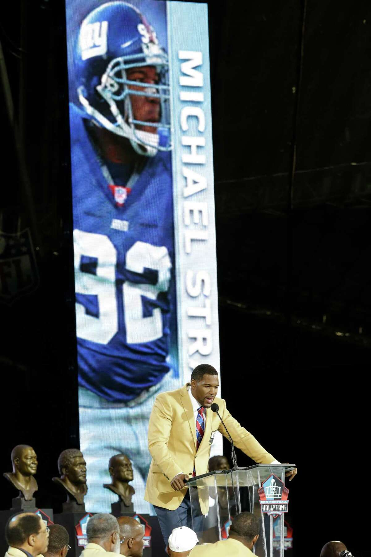 Hall of Fame inductee Michael Strahan speaks during the Pro Football Hall of Fame enshrinement ceremony at the Pro Football Hall of Fame on Saturday, Aug. 2, 2014, in Canton, Ohio. (AP Photo/Tony Dejak) ORG XMIT: OHTD128