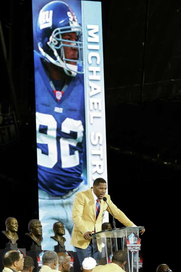 Hall of Fame inductee Michael Strahan speaks during the Pro Football Hall of Fame enshrinement ceremony at the Pro Football Hall of Fame on Saturday, Aug. 2, 2014, in Canton, Ohio. (AP Photo/Tony Dejak) ORG XMIT: OHTD128 Photo: Tony Dejak / AP