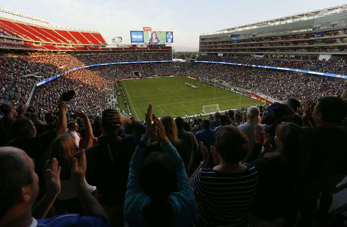 Fans applaud the National Anthem as the game is set to get underway, as the San Jose Earthquakes take on the Seattle Sounders in Major League Soccer action at the first ever event held at the new home of the San Francisco 49ers Levi's Stadium in Santa Clara, Calif. on Saturday August 2, 2014.