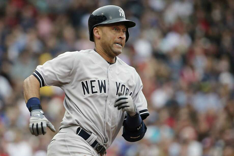 The Yankees' Derek Jeter rounds first after hitting a two-run double in the third inning Saturday. Photo: Winslow Townson / Associated Press / FR170221 AP