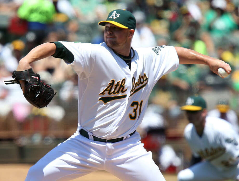 Jon Lester allowed three runs on nine hits with three strikeouts in his first game with Oakland. Photo: Anda Chu / Oakland Tribune / Oakland Tribune