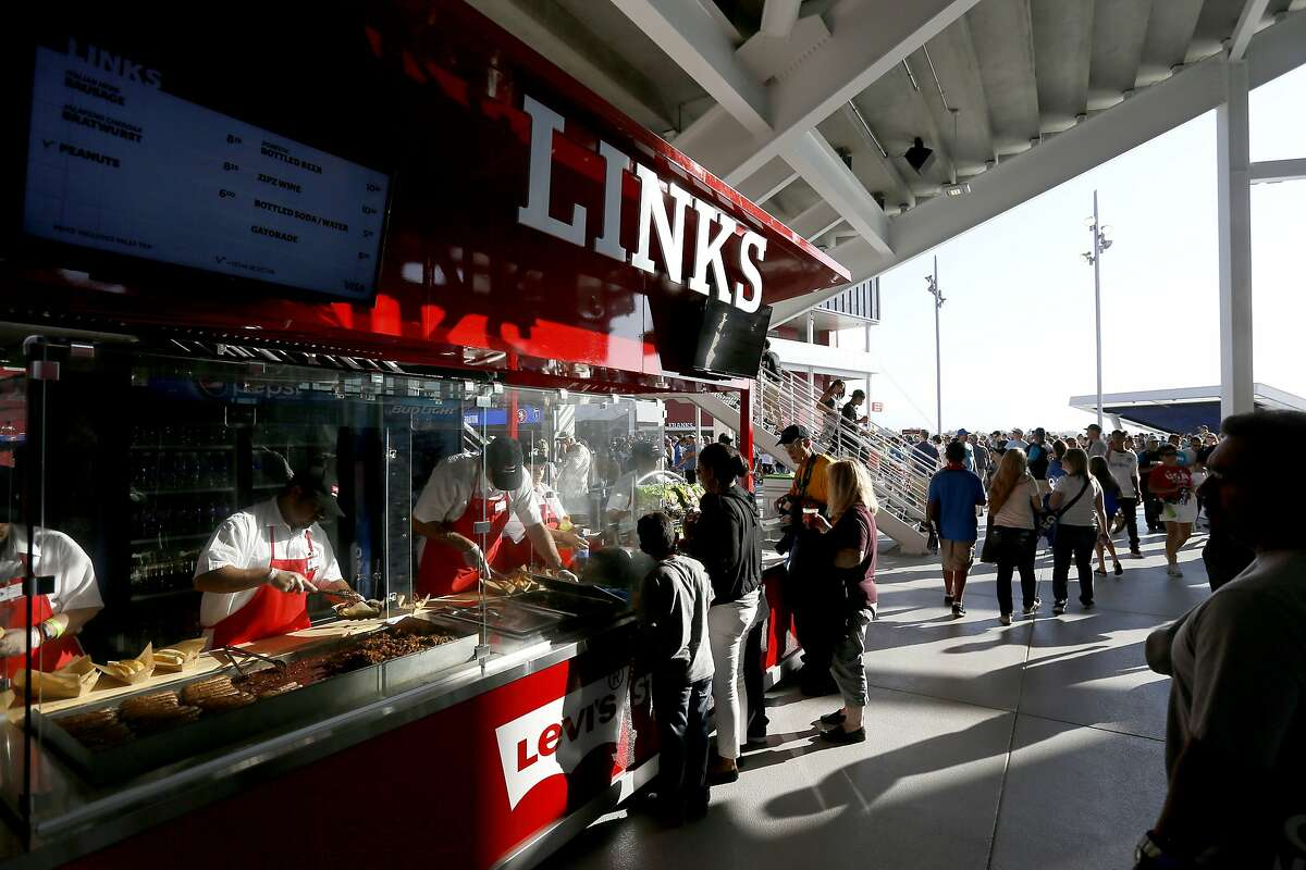 Fans load up on snacks before the start of the match as the San Jose Earthquakes prepare to take on the Seattle Sounders in Major League Soccer action at the first ever event held at the new home of the San Francisco 49ers Levi's Stadium in Santa Clara, Calif. on Saturday August 2, 2014.