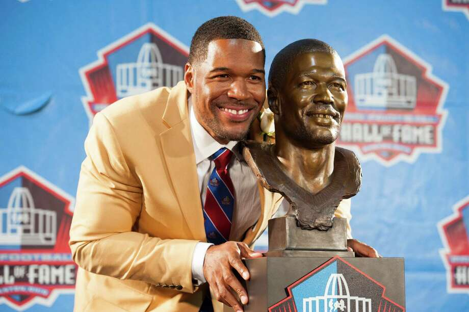 Michael Strahan's ever-present grin was on display in two places during Saturday night's induction ceremony in Canton, Ohio. Photo: Jason Miller, Stringer / 2014 Getty Images