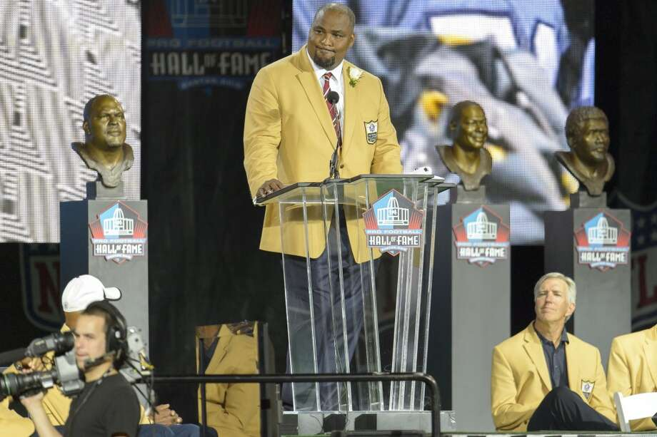 Former Seattle Seahawks tackle Walter Jones gives his speach during the NFL Class of 2014 Pro Football Hall of Fame Enshrinement Ceremony at Fawcett Stadium on August 2, 2014 in Canton, Ohio. Photo: Jason Miller, Getty Images