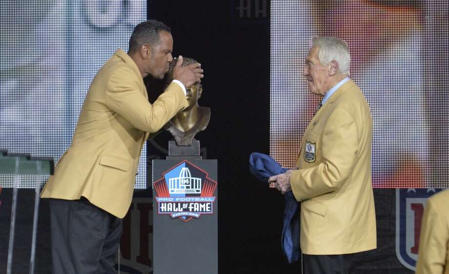 Hall of Fame inductee Andre Reed, left, kisses his bronze bust beside presenter Marv Levy during the 2014 Pro Football Hall of Fame Enshrinement Ceremony at the Pro Football Hall of Fame Saturday, Aug 2, 2014 in Canton, Ohio. Photo: David Richard, Associated Press