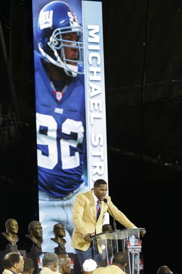 Hall of Fame inductee Michael Strahan speaks during the Pro Football Hall of Fame enshrinement ceremony at the Pro Football Hall of Fame on Saturday, Aug. 2, 2014, in Canton, Ohio. Photo: Tony Dejak, Associated Press