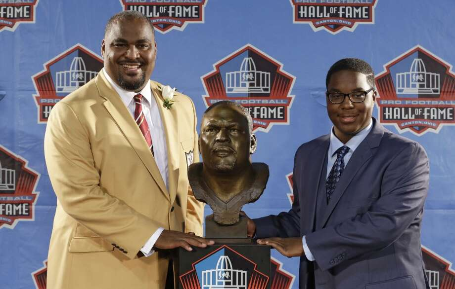 Hall of Fame inductee Walter Jones, left, and his son and presenter, Walterius Jones, pose with the bust during the Pro Football Hall of Fame enshrinement ceremony Saturday, Aug. 2, 2014, in Canton, Ohio. Photo: Tony Dejak, Associated Press