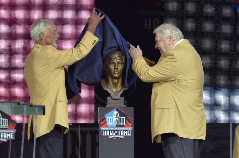 Hall of Fame inductee Ray Guy, left, uncovers his bronze bust with presenter John Madden during the 2014 Pro Football Hall of Fame Enshrinement Ceremony at the Pro Football Hall of Fame Saturday, Aug 2, 2014 in Canton, Ohio. Photo: David Richard, Associated Press