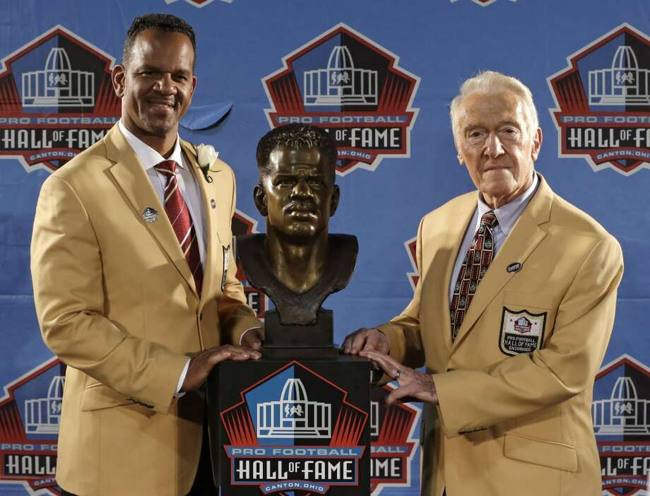 Hall of Fame inductee Andre Reed, left, and presenter Marv Levy pose with the bust during the 2014 Pro Football Hall of Fame Enshrinement Ceremony at the Pro Football Hall of Fame Saturday, Aug. 2, 2014, in Canton, Ohio. Photo: Tony Dejak, Associated Press