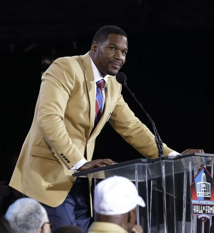 Hall of Fame inductee Michael Strahan speaks during the Pro Football Hall of Fame enshrinement ceremony Saturday, Aug. 2, 2014, in Canton, Ohio. Photo: Tony Dejak, Associated Press