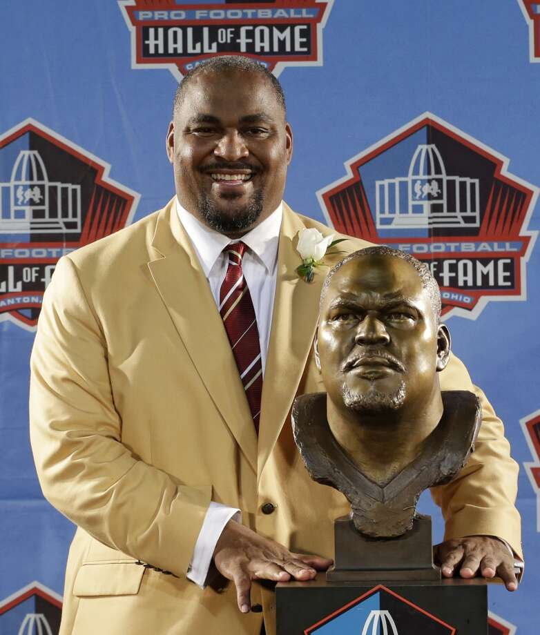 Hall of Fame inductee Walter Jones poses with his bust during the 2014 Pro Football Hall of Fame Enshrinement Ceremony at the Pro Football Hall of Fame Saturday, Aug. 2, 2014, in Canton, Ohio. Photo: Tony Dejak, Associated Press