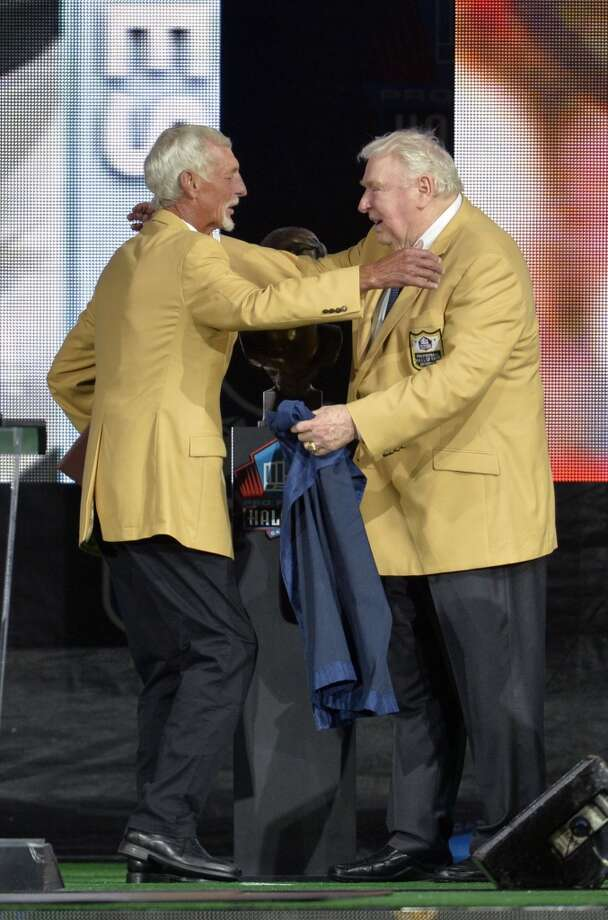 Hall of Fame inductee Ray Guy, left, hugs his presenter John Madden during the 2014 Pro Football Hall of Fame Enshrinement Ceremony at the Pro Football Hall of Fame Saturday, Aug 2, 2014 in Canton, Ohio. Photo: David Richard, Associated Press