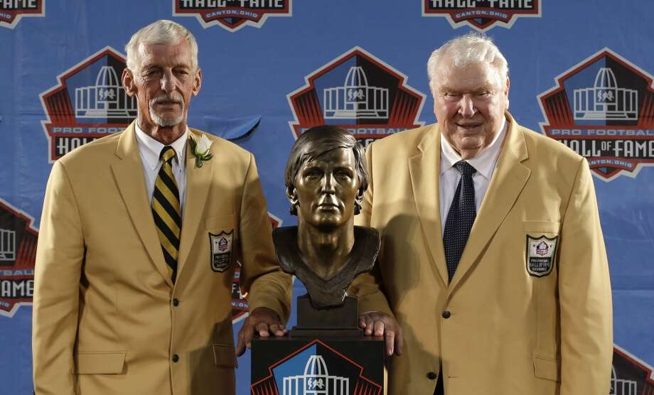 Hall of Fame inductee Ray Guy, left, and presenter John Madden pose with the bust during the 2014 Pro Football Hall of Fame Enshrinement Ceremony at the Pro Football Hall of Fame Saturday, Aug. 2, 2014, in Canton, Ohio. Photo: Tony Dejak, Associated Press