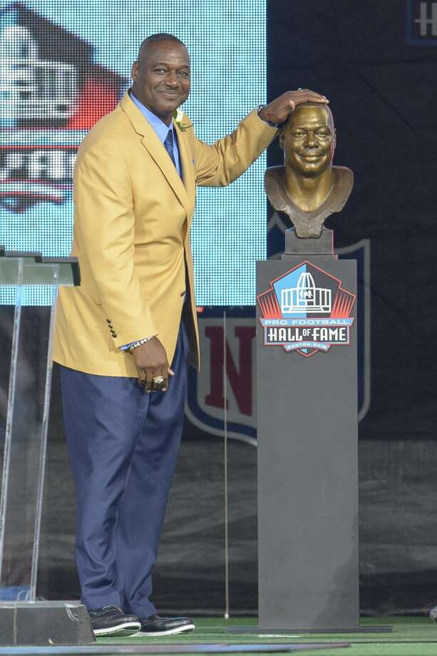 Former Tampa Buccaneers linebacker Derrick Brooks, right, unveils his bust with his son Decalon Brooks, left, during the NFL Class of 2014 Pro Football Hall of Fame Enshrinement Ceremony at Fawcett Stadium on August 2, 2014 in Canton, Ohio. Photo: Jason Miller, Getty Images