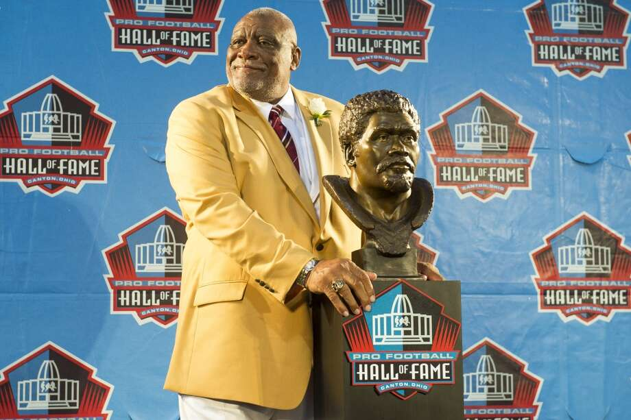 Former NFL defensive end Claude Humphrey with his bust during the NFL Class of 2014 Pro Football Hall of Fame Enshrinement Ceremony at Fawcett Stadium on August 2, 2014 in Canton, Ohio. Photo: Jason Miller, Getty Images