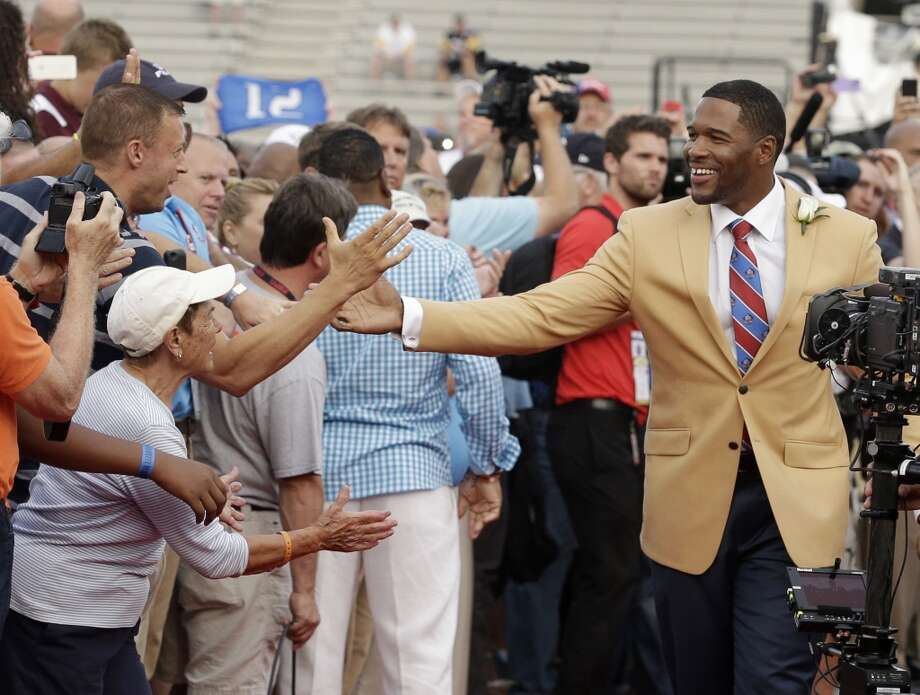Hall of Fame Inductee Michael Strahan greets fans during the 2014 Pro Football Hall of Fame Enshrinement Ceremony at the Pro Football Hall of Fame Saturday, Aug. 2, 2014, in Canton, Ohio. Photo: Tony Dejak, Associated Press