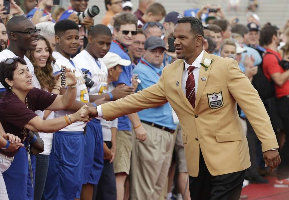 Hall of Fame Inductee Andre Reed greets fans as he is introduced during the 2014 Pro Football Hall of Fame Enshrinement Ceremony at the Pro Football Hall of Fame Saturday, Aug. 2, 2014, in Canton, Ohio. Photo: Tony Dejak, Associated Press