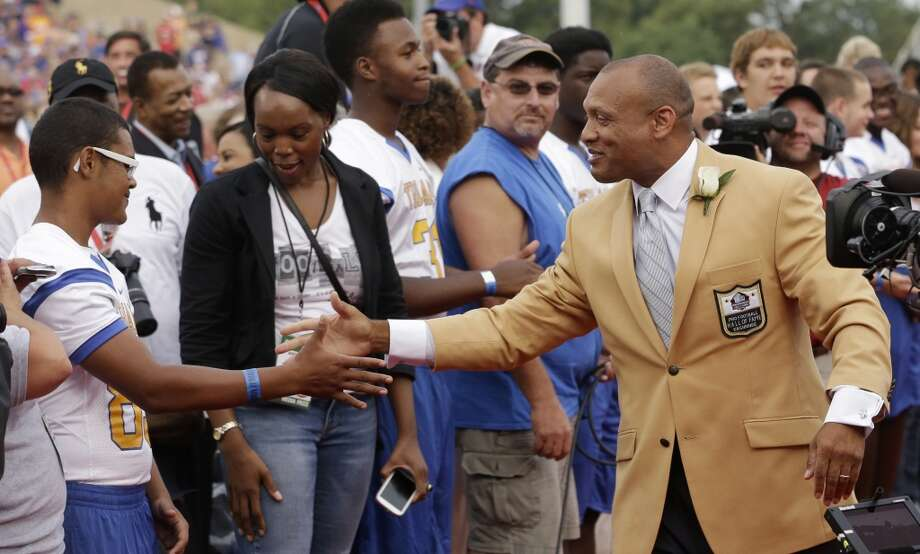 Hall of Fame Inductee Aeneas Williams greets fans as he is introduced during the 2014 Pro Football Hall of Fame Enshrinement Ceremony at the Pro Football Hall of Fame Saturday, Aug. 2, 2014, in Canton, Ohio. Photo: Tony Dejak, Associated Press