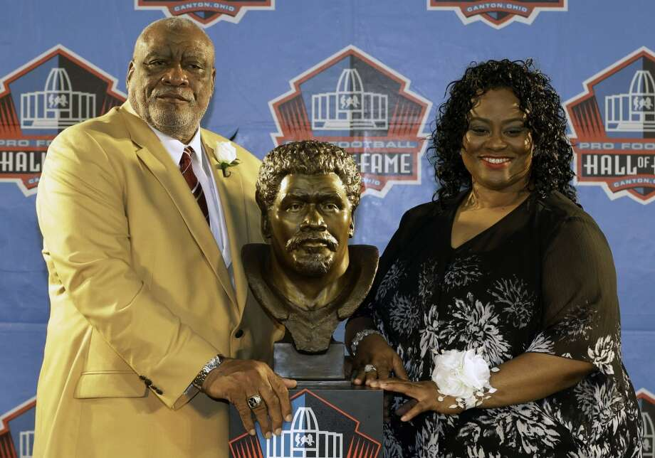 Hall of Fame Inductee Claude Humphrey poses with his daughter, his presenter Cheyenne Humphrey-Robinson, during the 2014 Pro Football Hall of Fame Enshrinement Ceremony at the Pro Football Hall of Fame Saturday, Aug. 2, 2014, in Canton, Ohio. Photo: Tony Dejak, Associated Press
